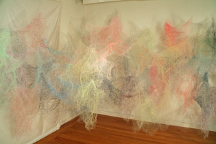 """Mind/Ocean"" (View 2) 20'L x 8'H x 6'D, Polyester tulle, thread and monofilament wire, 2017"