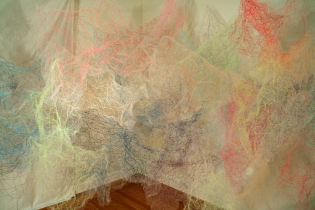 """Mind/Ocean"" (Detail 1) 20'L x 8'H x 6'D, Polyester tulle, thread and monofilament wire, 2017"