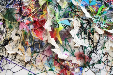 "3. ""Hidden Inheritance,"" (Detail) 2014, Collage paper, plastic bags, string, tulle, garland, 7'H x 10'L x 3""D."