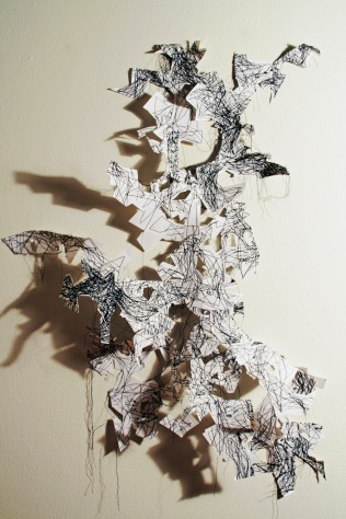 "1. ""Broken Flight"" (Overview) 2016, Paper and thread, 2'6""H x 2'2""W."