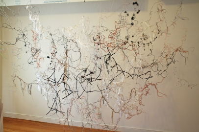 """1. """"Float,"""" (Overview) 2014, Wire, rope, string, oxygen tubing, and tulle, 7'H x 8'W x 5'D."""