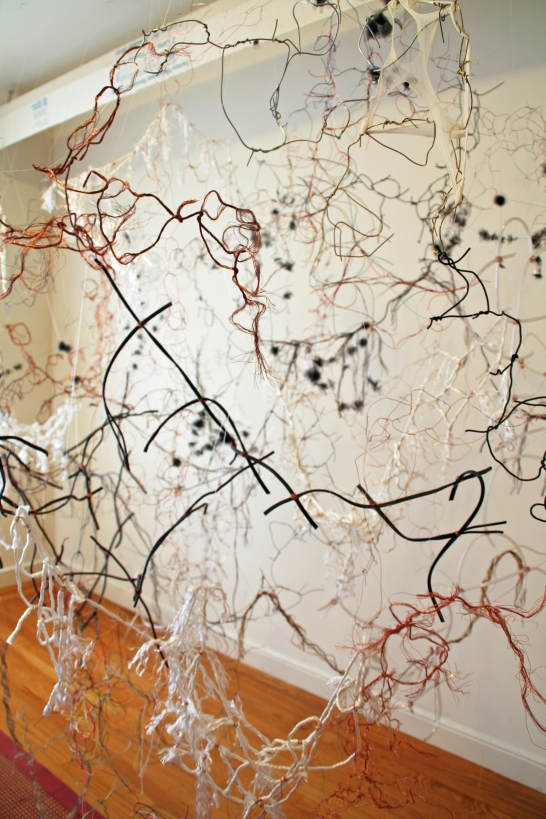 """4. """"Float,"""" (Detail) 2014, Wire, rope, string, oxygen tubing, and tulle, 7'H x 8'W x 5'D."""