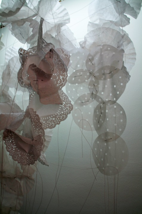 """Soft Story,"" (Detail 3) Coffee filters, string, and pins, 4'H x 2'6″W x 1'D, 2011"