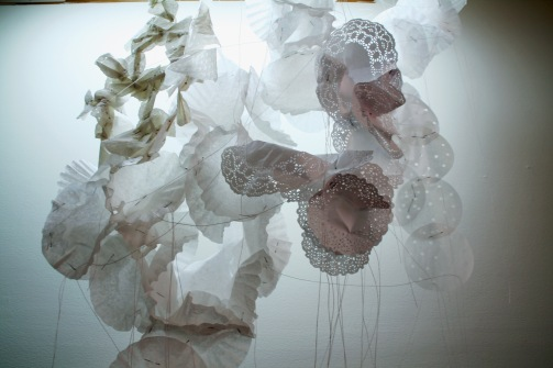 """Soft Story,"" (Mid-view) Coffee filters, string, and pins, 4'H x 2'6″W x 1'D, 2011"