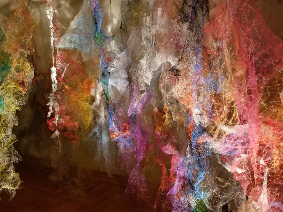 """Mind/Forest I"" (Right Side) 2018, Polyester tulle, produce netting, thread, duralene plastic, plastic rope, and cotton gauze, 13'L x 18'W x 9'H."
