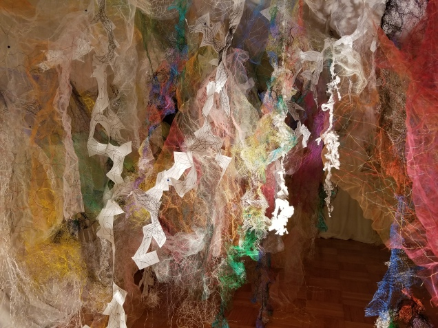 """Mind/Forest I"" (Left Side) 2018, Polyester tulle, produce netting, thread, duralene plastic, plastic rope, and cotton gauze, 13'L x 18'W x 9'H."